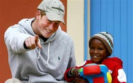 Prince Harry with African child